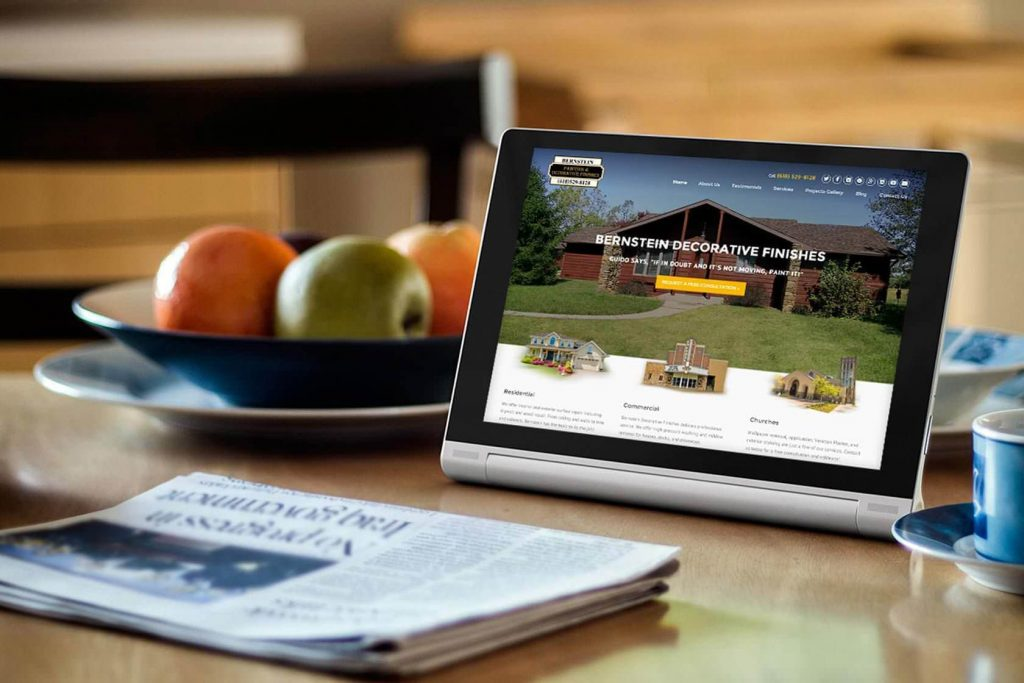 Image of tablet on kitchen counter next to bowl of fruit.